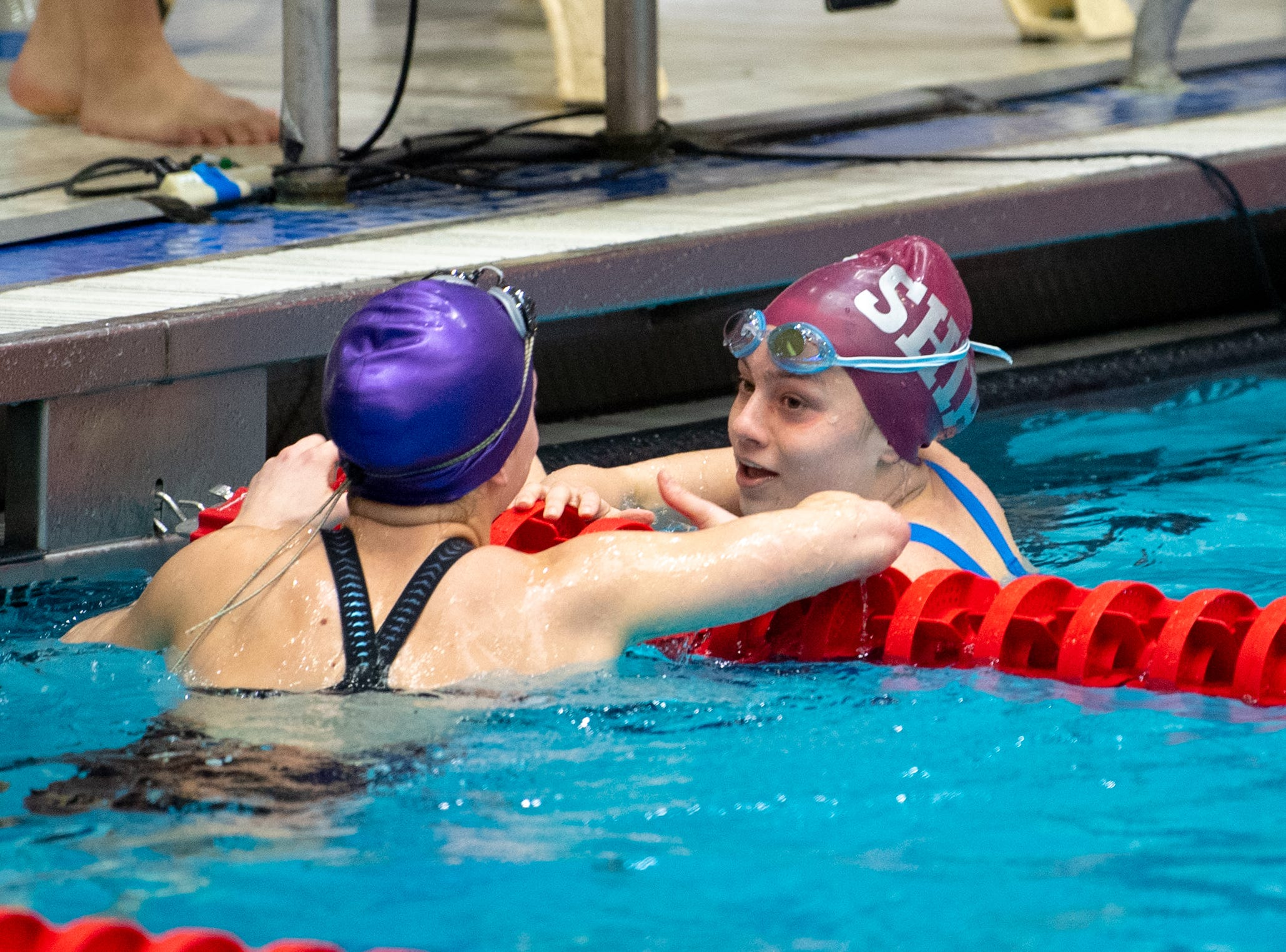 Teddi Powell of Shippensburg (right) shakes hands with Abbie Erme of Boiling Springs (left) after the Girls 50 Yard Freestyle during the PIAA District 3 Girls AA Championship, March 1, 2019 at Cumberland Valley High School.