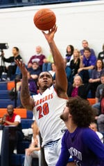 Marquise McClean (20) shoots a floater during the 5A district third-place game between York High and Northern York, February 28, 2019 at William Penn Senior High School. The Bearcats defeated the Polar Bears 86 to 68.