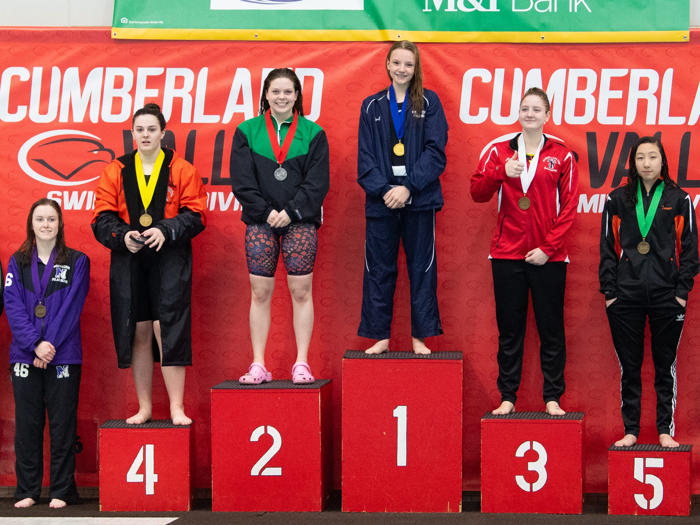 Medalists of the Girls 200 IM stand on the podium during the PIAA District 3 Girls AA Championship, March 1, 2019 at Cumberland Valley High School.