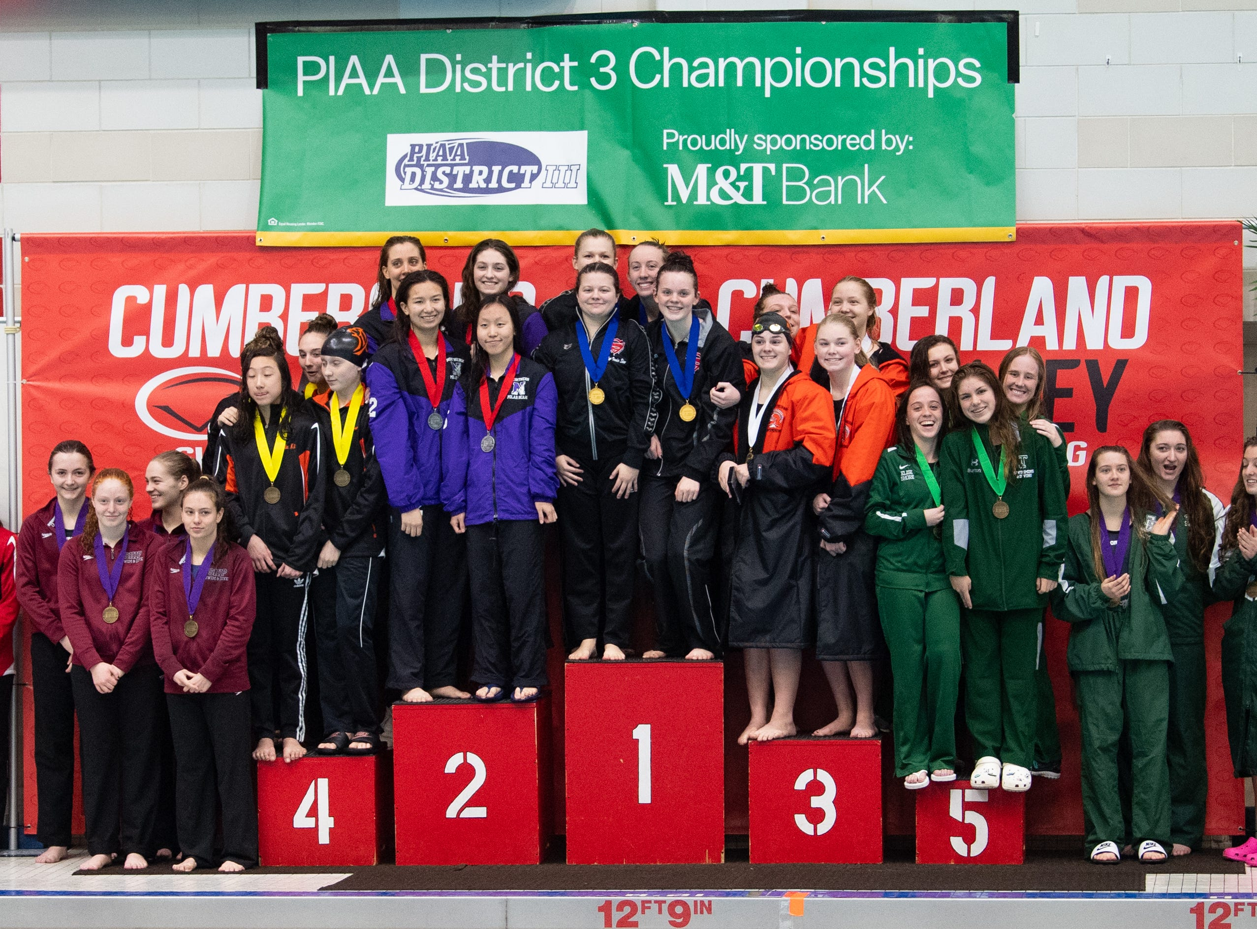 The winners of the Girls 200 Yard Medley Relay stand proudly on the podium during the PIAA District 3 Girls AA Championship, March 1, 2019 at Cumberland Valley High School.