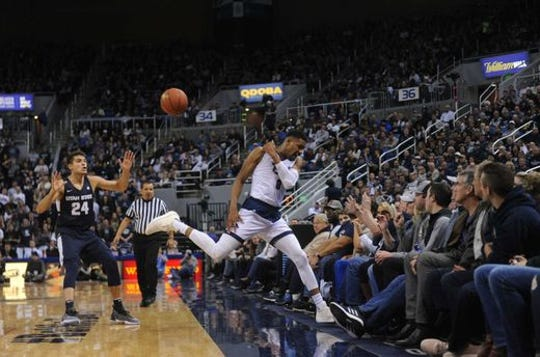 Nevada's Tre'Shawn Thurman goes out of bounds to make a save during the Wolf Pack's 72-49 win over Utah State on Jan. 2.