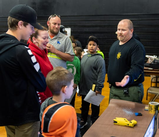 Sgt. Chris Bixby from the Lyon County Sheriff's Office explains how a Taser works.