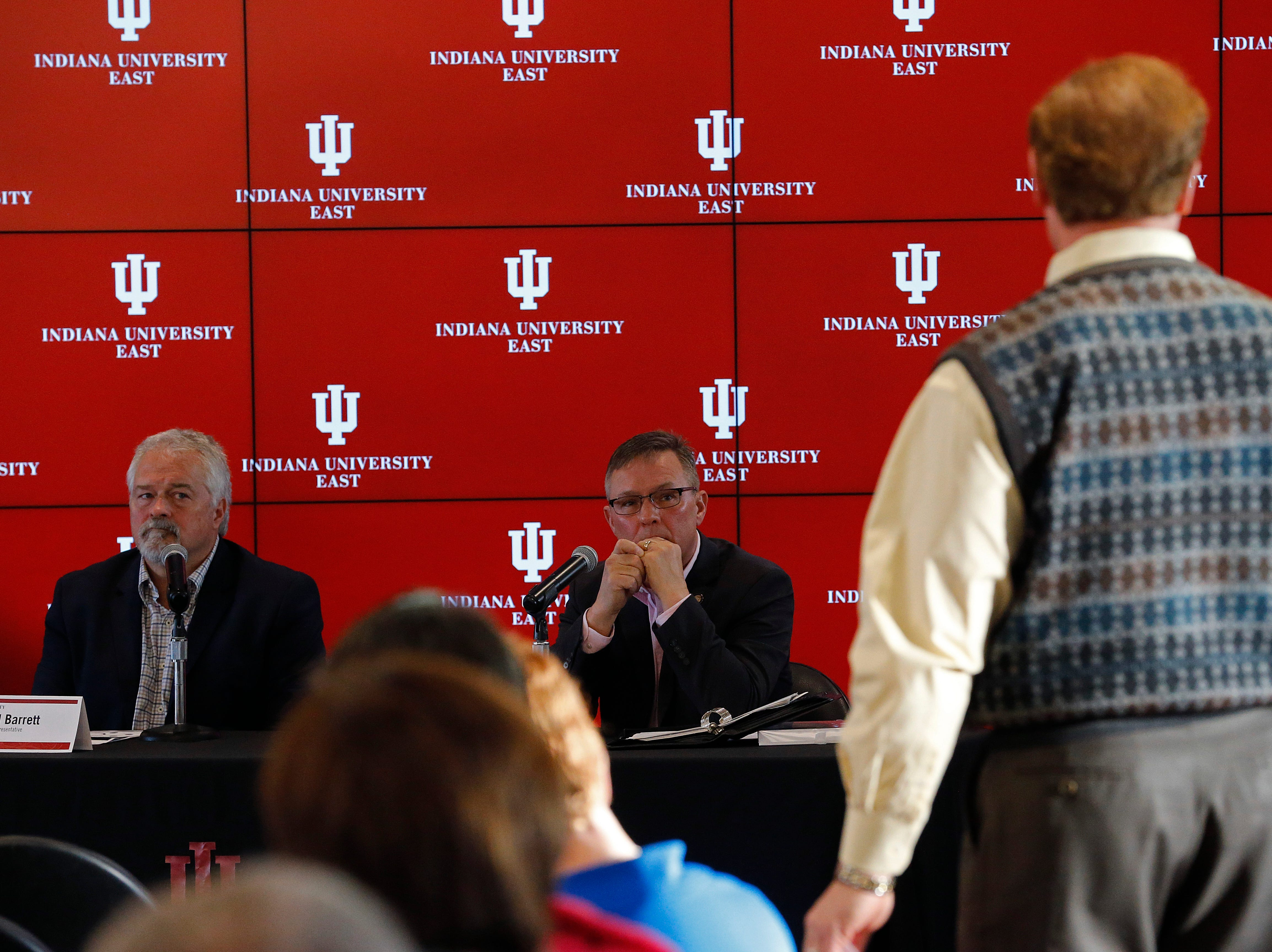 State Rep. Brad Barrett (left) and State Sen. Jeff Raatz (center) listen to an audience member's question during Friday's Legislative Forum at IU East.