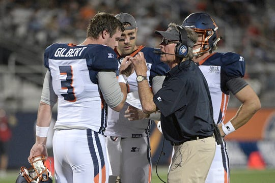 Orlando Apollos coach Steve Spurrier, right, talks with quarterback Garrett Gilbert (3) on the sideline during a timeout in the first half of the team's Alliance of American Football game against the Memphis Express.
