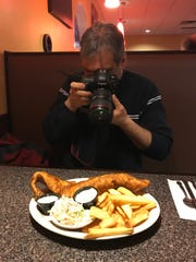Shown Dowd photographs a fish fry.