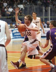 Cal-Mum's Eric Wilson drives to the basket against York.