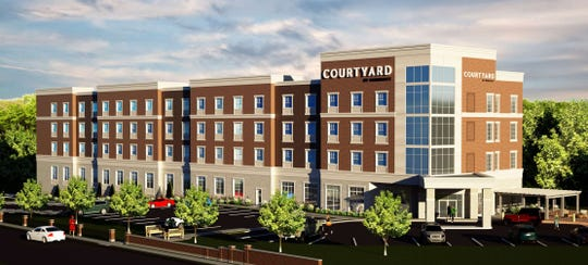 This is the latest proposal for a Courtyard by Marriott hotel to replace the East Avenue Inn & Suites in Rochester's End End district.
