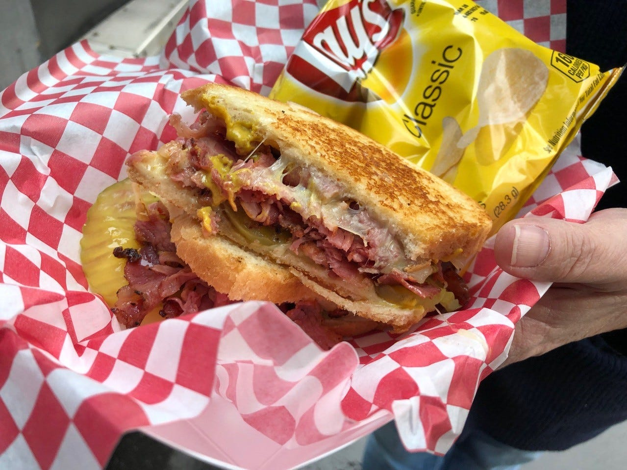 Blue Shield employee Mary Turner always orders the hot pastrami sandwich from What the Truck food truck.