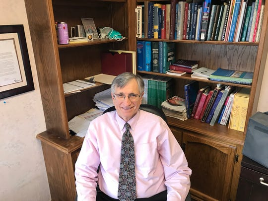Dr. Thomas Perry, shown in his Redding office, has been a practicing ob-gyn since 1981.
