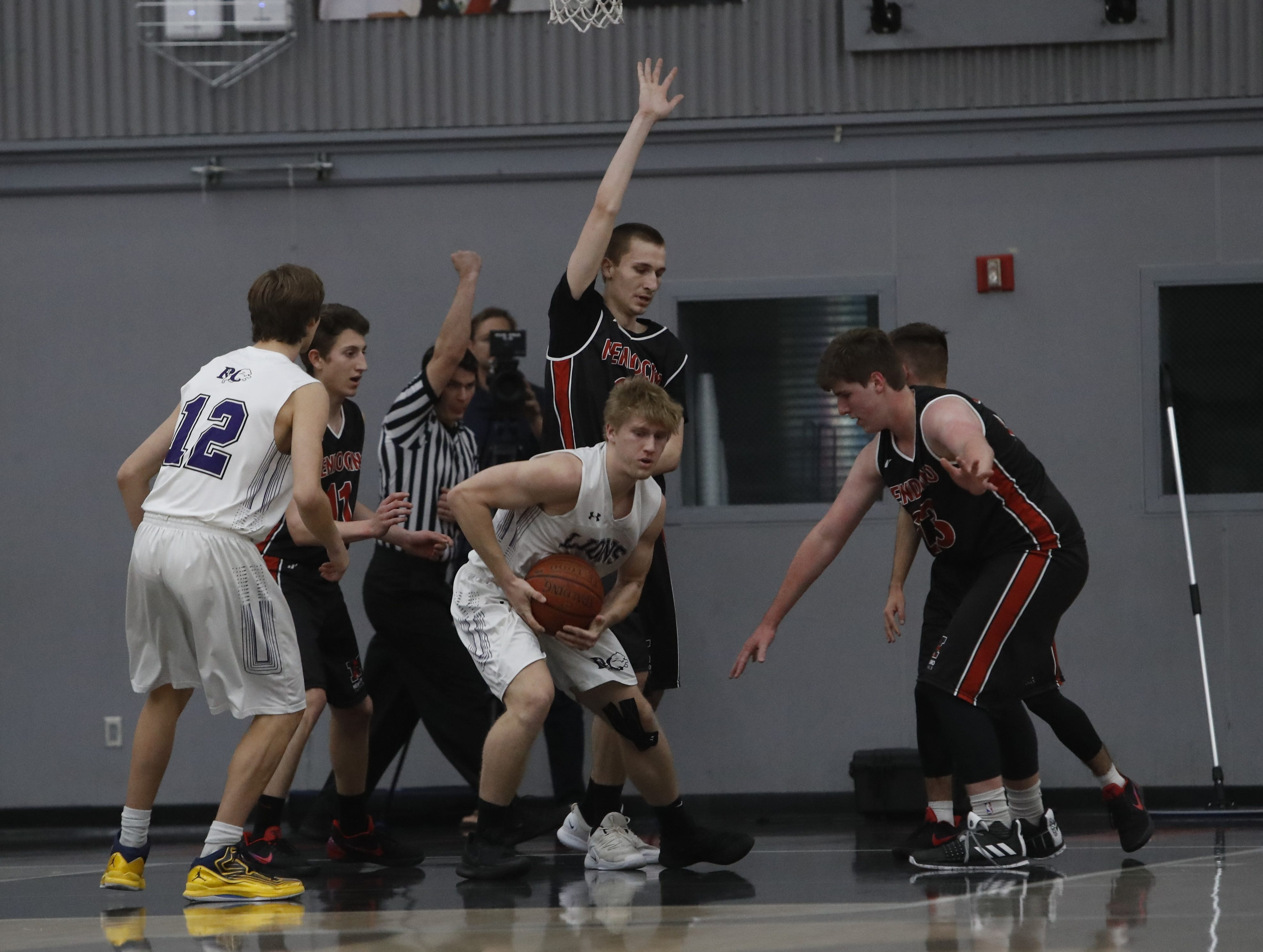 The Redding Christian Lions beat Mendocino, 60-48, at Foothill High to advance into the semifinals of the NorCal Division VI bracket on Thursday, Feb. 28.