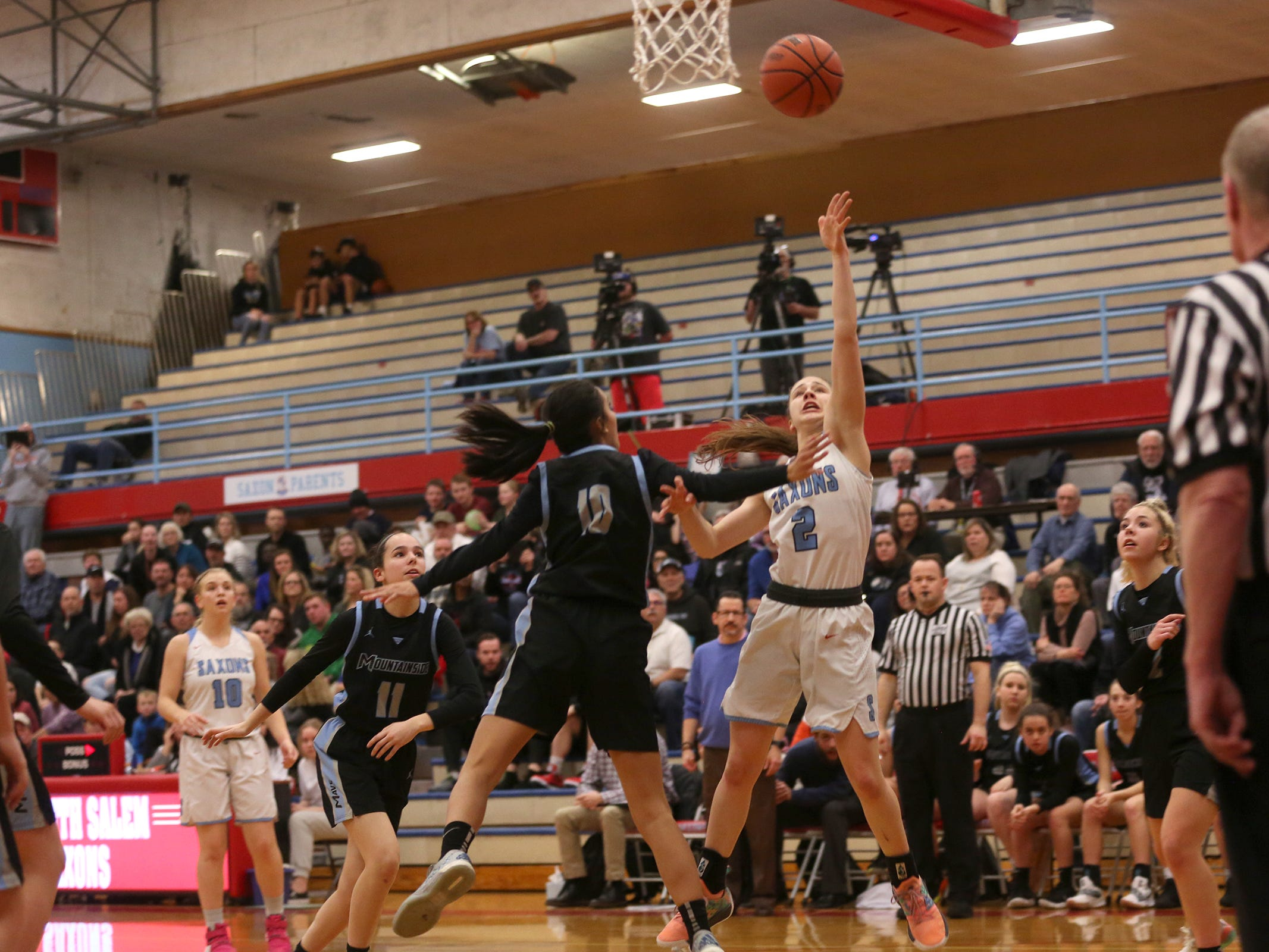 South Salem's Hilary James (2) goes up for a shot during the South Salem vs. Mountainside girls basketball OSAA playoff game in Salem on Thursday, Feb. 28, 2019.
