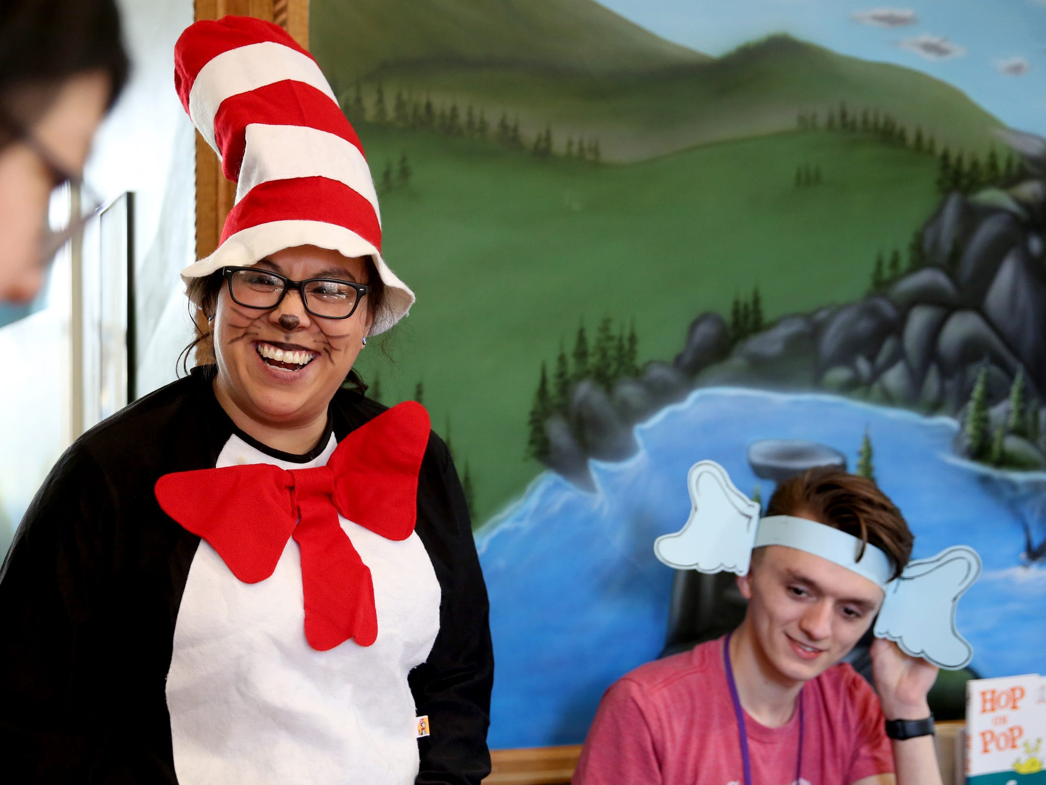 Patricia McNab, the community relations coordinator with Gilbert House Children's Museum, and Cody Cody Broughton, a visitor services associate, dress as Dr. Seuss characters the Cat in the Hat and Horton, respectively, as part of a National Read Across America Day activity in honor of Dr. Seuss' birthday at Gilbert House Children's Museum in Salem  on Friday, March 1, 2019.