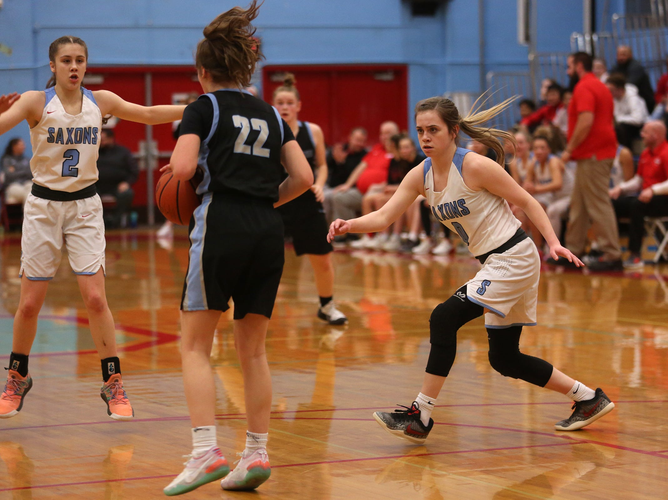 South Salem's Hilary James (2) and Ellyson Haytas (2) play defense against Mountainside's Halle Hageman (22) during the South Salem vs. Mountainside girls basketball OSAA playoff game in Salem on Thursday, Feb. 28, 2019.