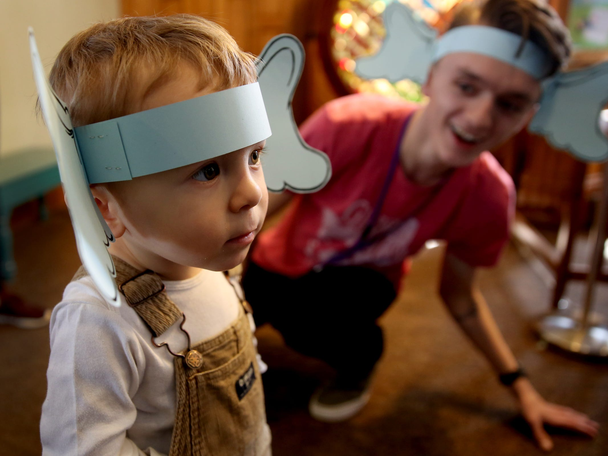 """Jules Prickett, 2, of Salem, wears ears like Horton from """"Horton Hears a Who"""" as part of a National Read Across America Day activity in honor of Dr. Seuss' birthday at Gilbert House Children's Museum in Salem  on Friday, March 1, 2019."""