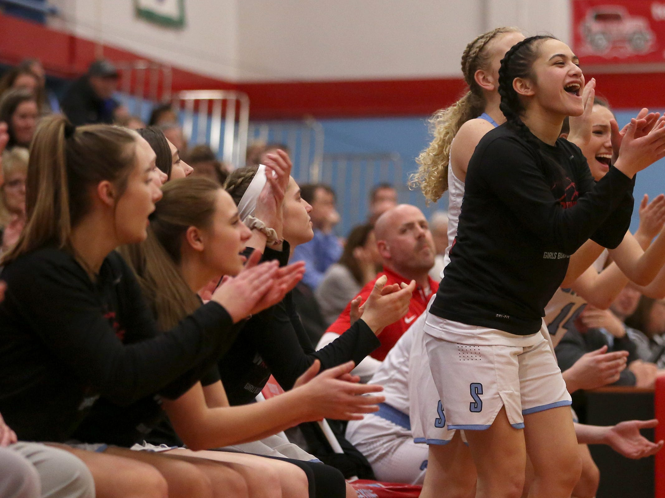 South Salem's bench cheers on their team during the South Salem vs. Mountainside girls basketball OSAA playoff game in Salem on Thursday, Feb. 28, 2019.