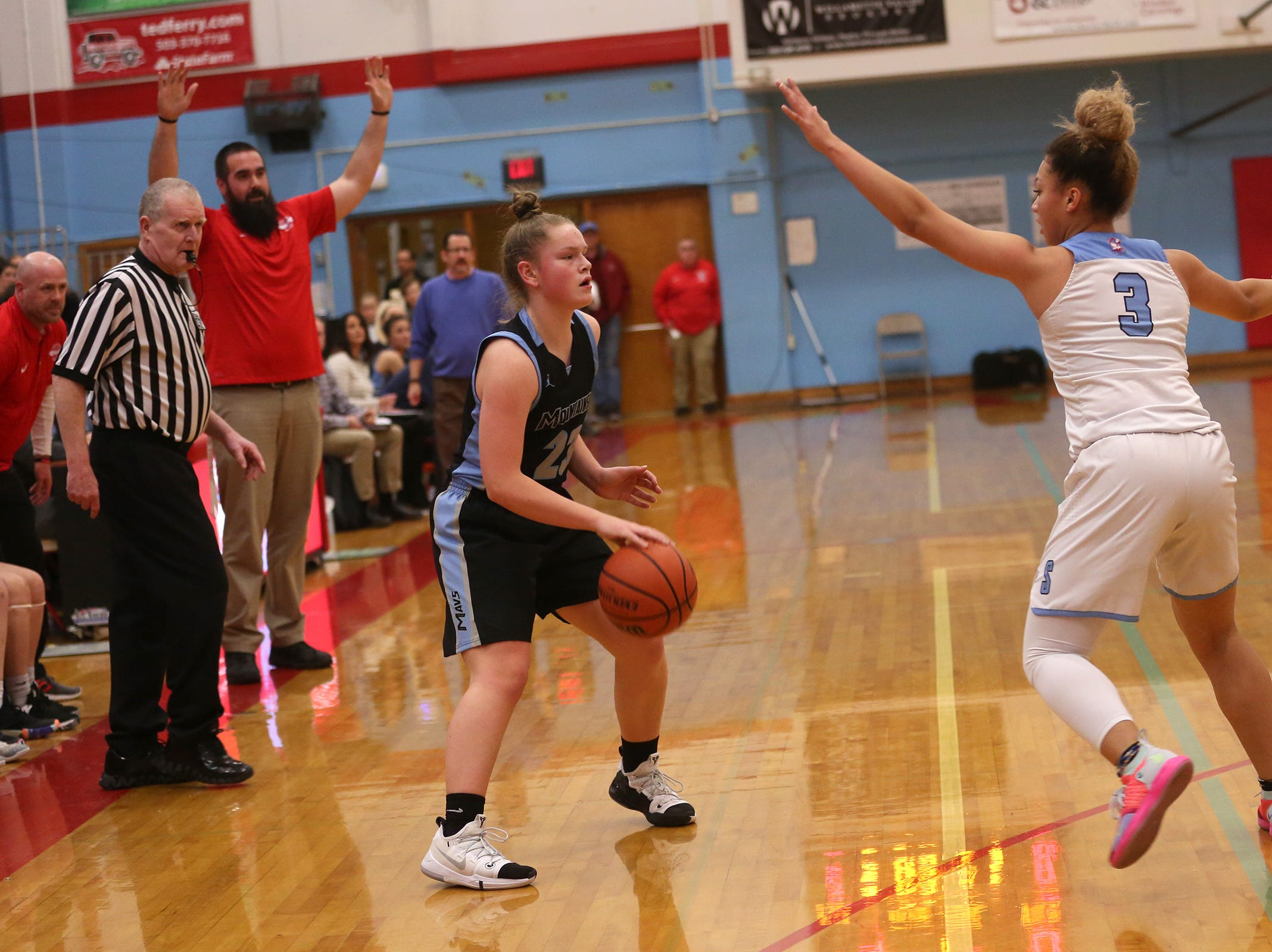 South Salem's Maylah Bolden (3) attempts to block Mountainside's Carly Stone (23) during the South Salem vs. Mountainside girls basketball OSAA playoff game in Salem on Thursday, Feb. 28, 2019.