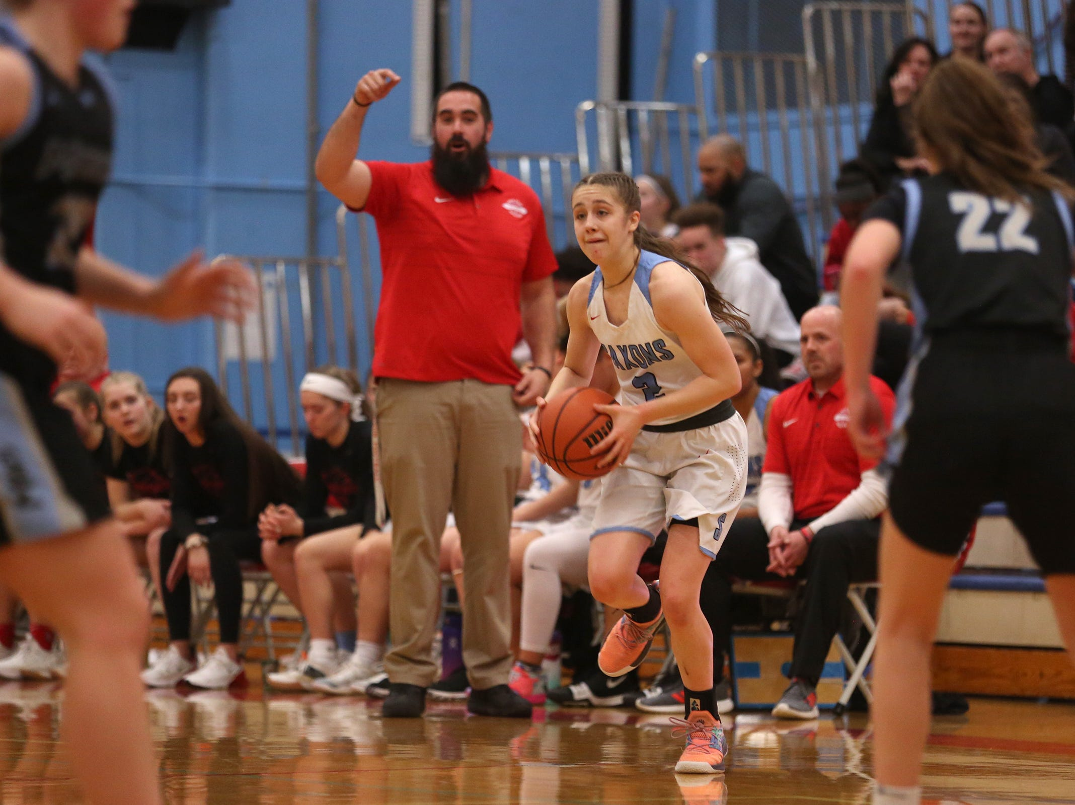 South Salem's Hilary James (2) looks to make a pass during the South Salem vs. Mountainside girls basketball OSAA playoff game in Salem on Thursday, Feb. 28, 2019.