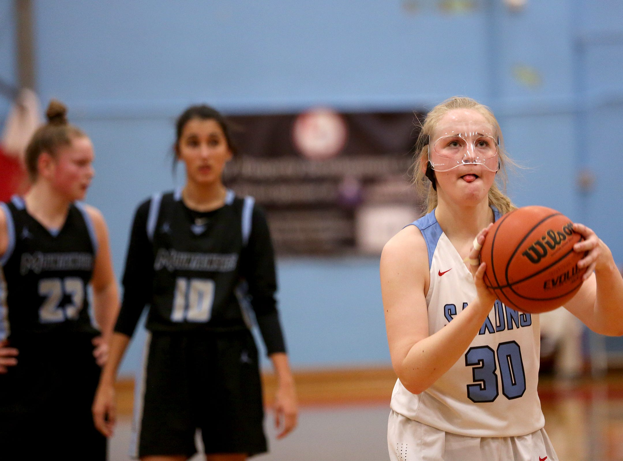 South Salem's Gretchen Olsen (30) gets two shots at the line during the South Salem vs. Mountainside girls basketball OSAA playoff game in Salem on Thursday, Feb. 28, 2019.