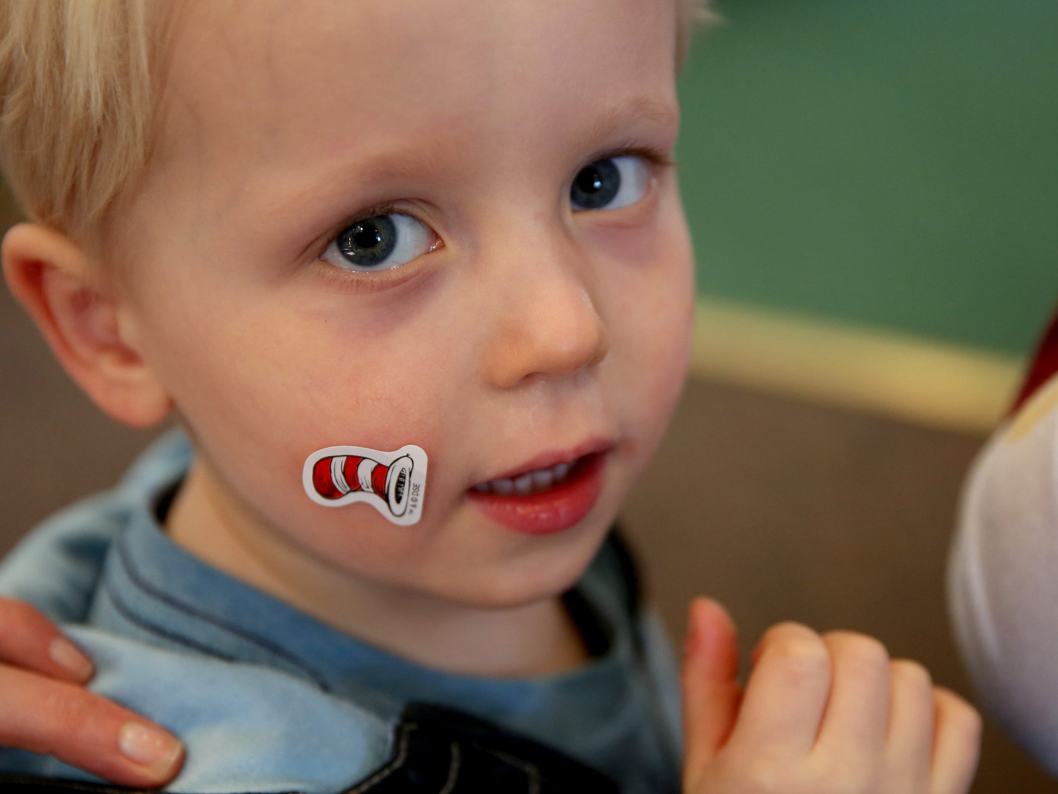 Caleb Joslin, 4, of Salem, wears a Cat in the Hat sticker as part of a National Read Across America Day activity in honor of Dr. Seuss' birthday at Gilbert House Children's Museum in Salem  on Friday, March 1, 2019.