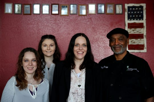 Co-owners, from left, Renae Greenberg, Raeleen Daniel, and Jeaeen Greenberg, and head chef Greggery Peterson stand for a photo at the Independence Grill & Bar in Independence on Thursday, Feb. 28, 2019. Jeaneen Greenberg and her two daughters are the new owners of the restaurant, but former-owner Peterson will stay on as head chef.