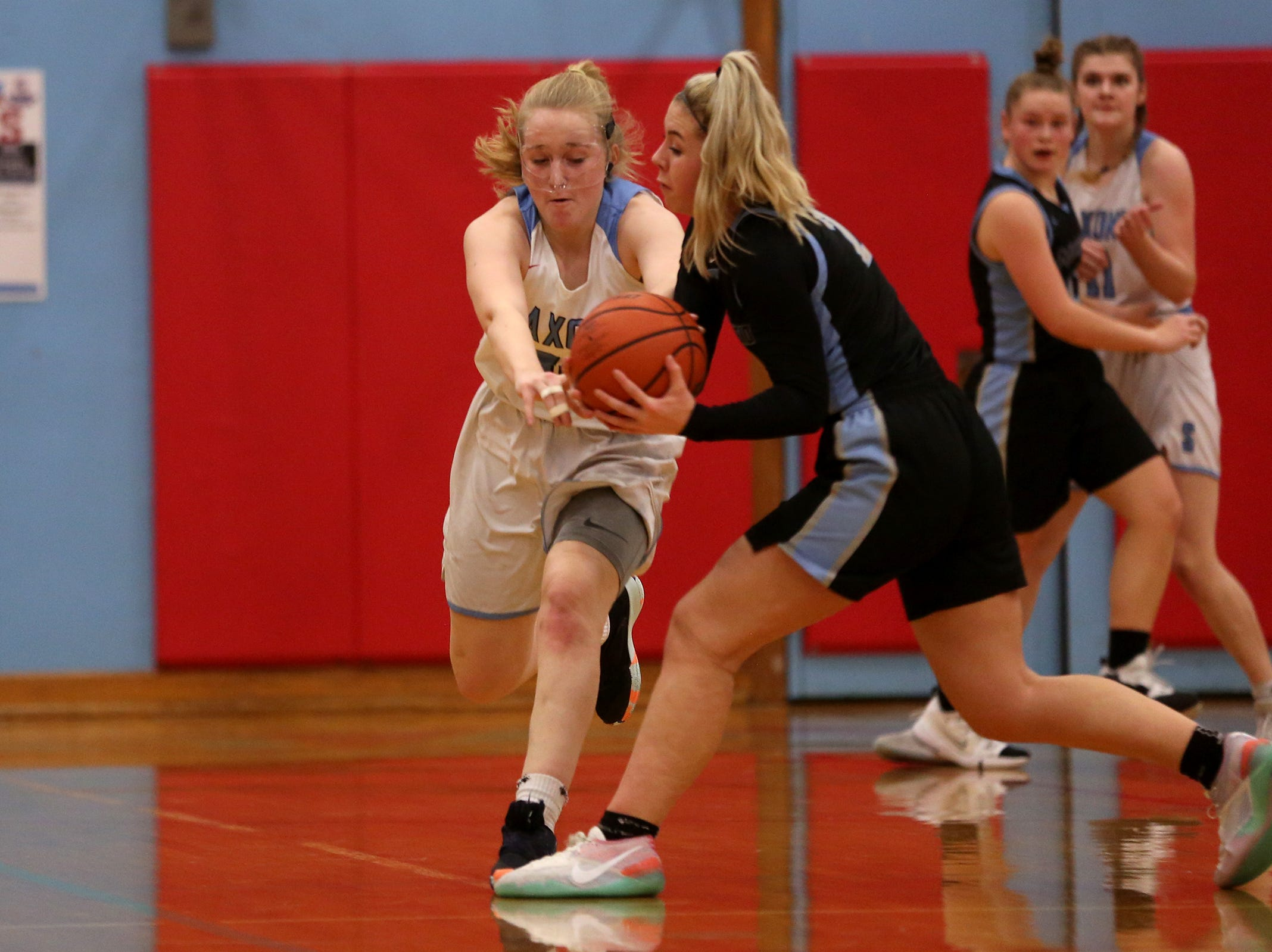 South Salem's Gretchen Olsen (30) attempts a steal during the South Salem vs. Mountainside girls basketball OSAA playoff game in Salem on Thursday, Feb. 28, 2019.