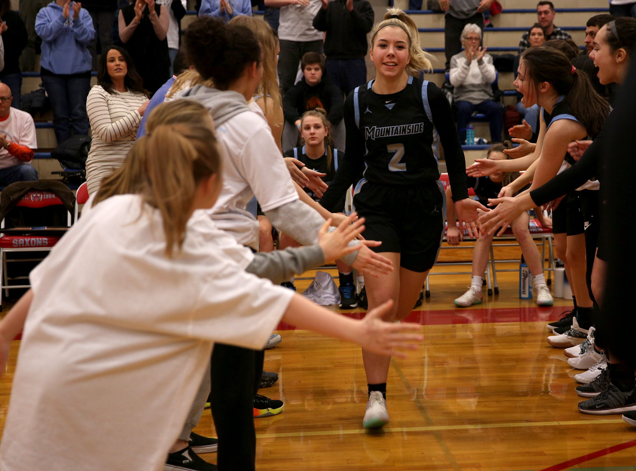 Mountainside's Hailey Lines (2) is introduced in the starting lineup during the South Salem vs. Mountainside girls basketball OSAA playoff game in Salem on Thursday, Feb. 28, 2019.