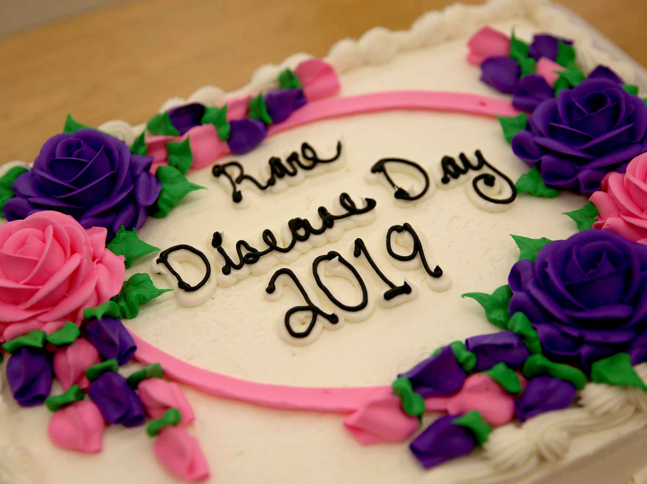 Haley Pollman and her mother Melissa Pollman serve cake to her classmates on rare disease day at Lee Elementary School in Salem on Thursday, Feb. 28, 2019.