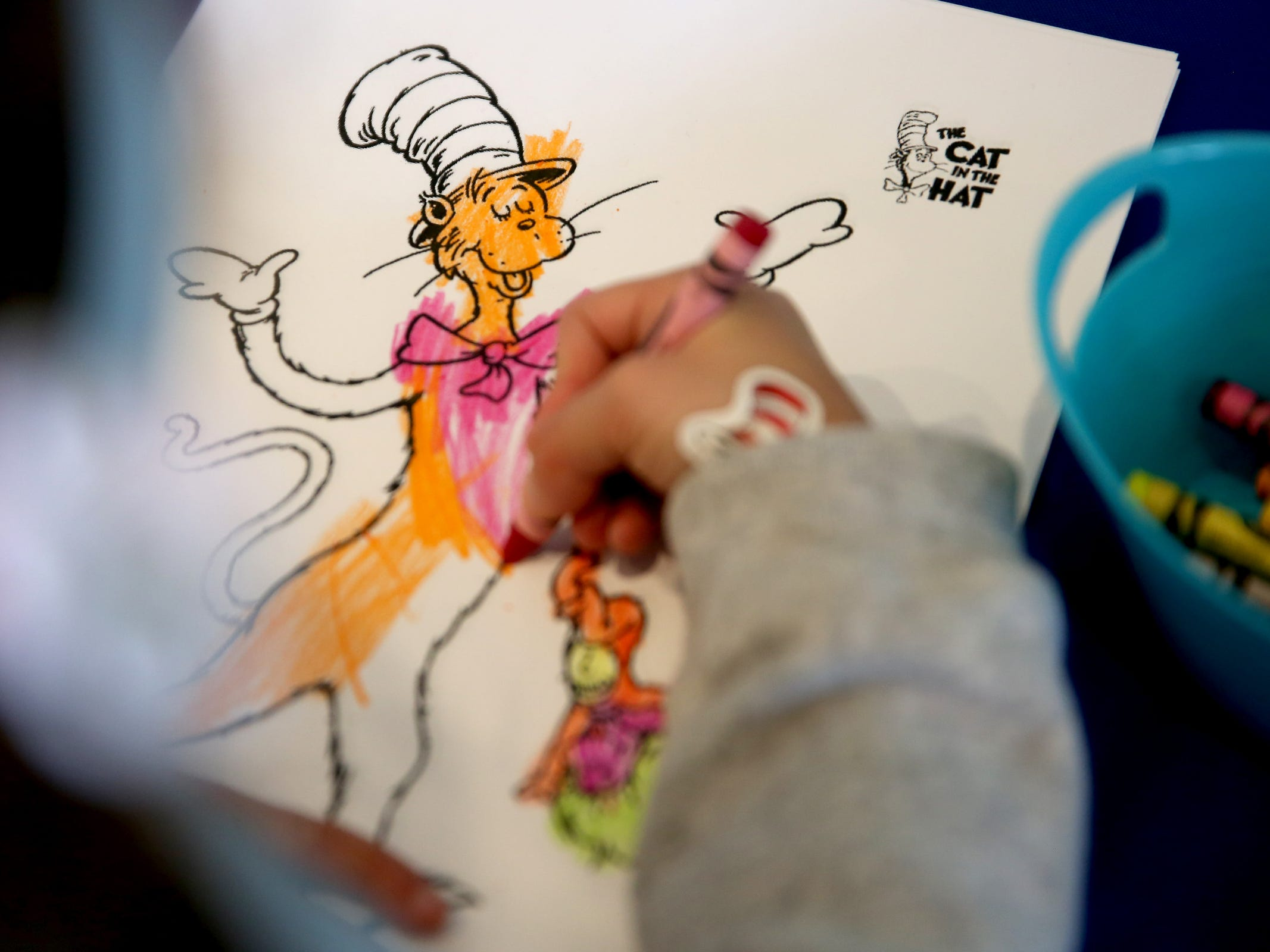 Clara Prickett, 4, of Salem, colors as part of a National Read Across America Day activity in honor of Dr. Seuss' birthday at Gilbert House Children's Museum in Salem  on Friday, March 1, 2019.