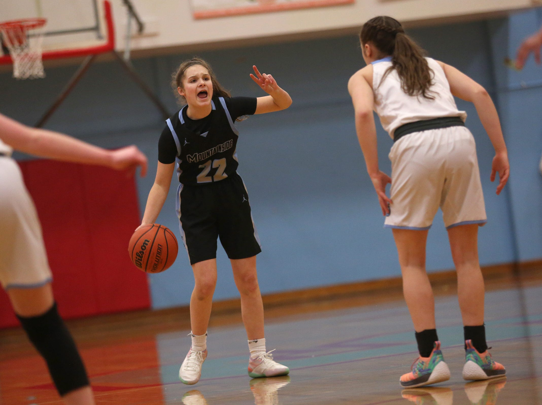 Mountainside's Halle Hageman (22) calls out to a play during the South Salem vs. Mountainside girls basketball OSAA playoff game in Salem on Thursday, Feb. 28, 2019.