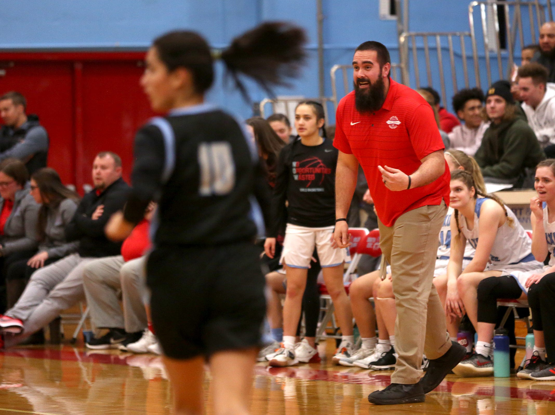 South Salem's head coach Adrian Lewis calls out a play during the South Salem vs. Mountainside girls basketball OSAA playoff game in Salem on Thursday, Feb. 28, 2019.