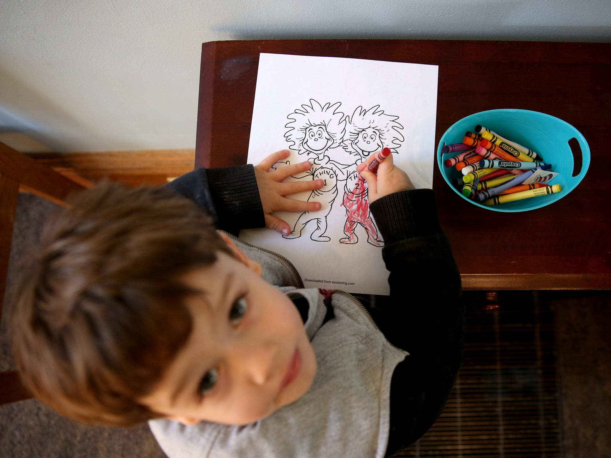 Jackson Evans, 4, of Salem, colors as part of a National Read Across America Day activity in honor of Dr. Seuss' birthday at Gilbert House Children's Museum in Salem  on Friday, March 1, 2019.