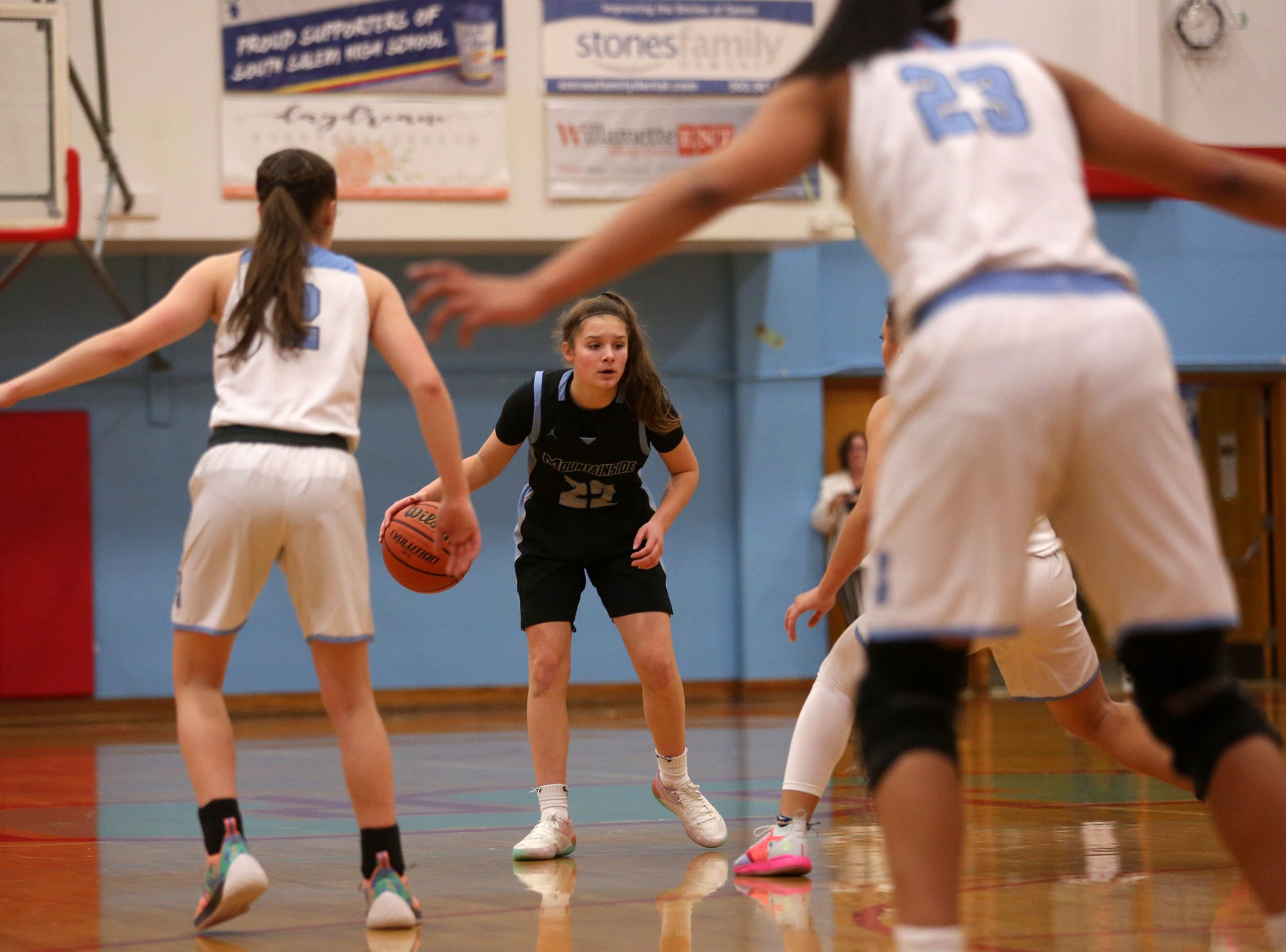 Mountainside's Halle Hageman (22) looks to make a pass during the South Salem vs. Mountainside girls basketball OSAA playoff game in Salem on Thursday, Feb. 28, 2019.