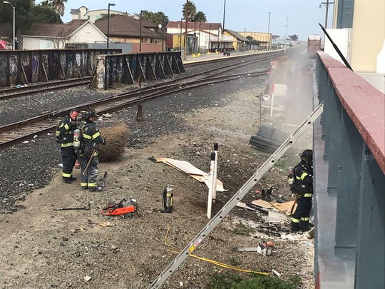 Salinas firefighters respond to a fire near Bridge and Lake streets early Friday morning.