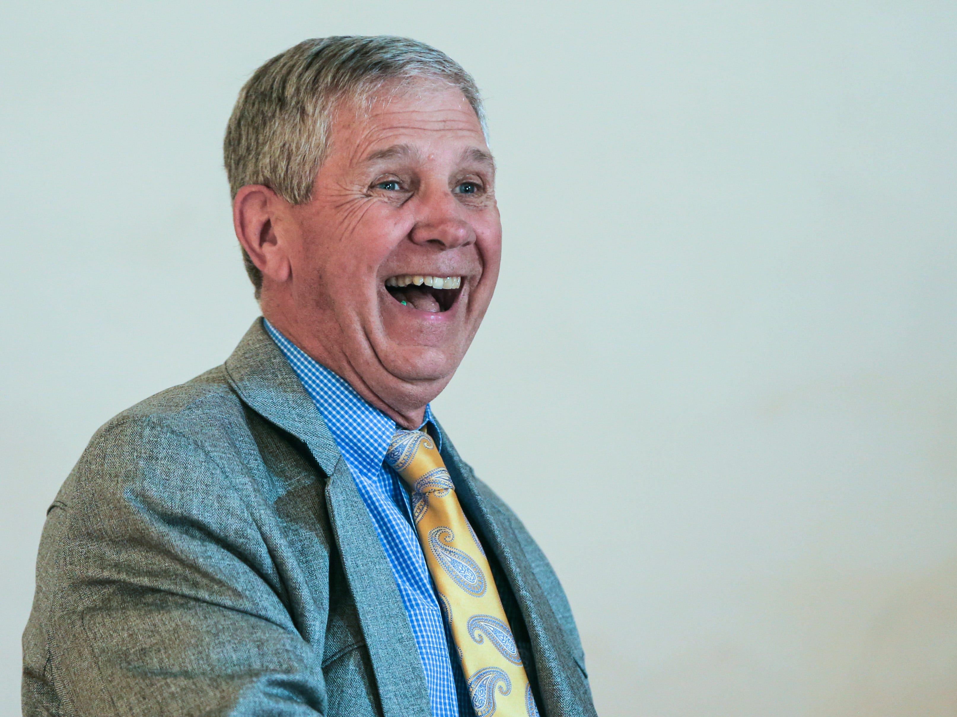 Justice Allen Gilbert laughs at comments from a speaker during his retirement party Friday, March 1, 2019, at Fort Concho.