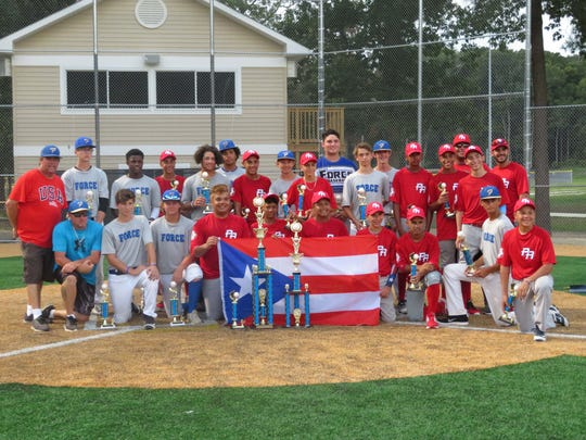 Players from the Eastern Shore FORCE baseball team and a team from Puerto Rico pose for a photograph in 2018, when the Puerto Rican team traveled to the Eastern Shore of Maryland.