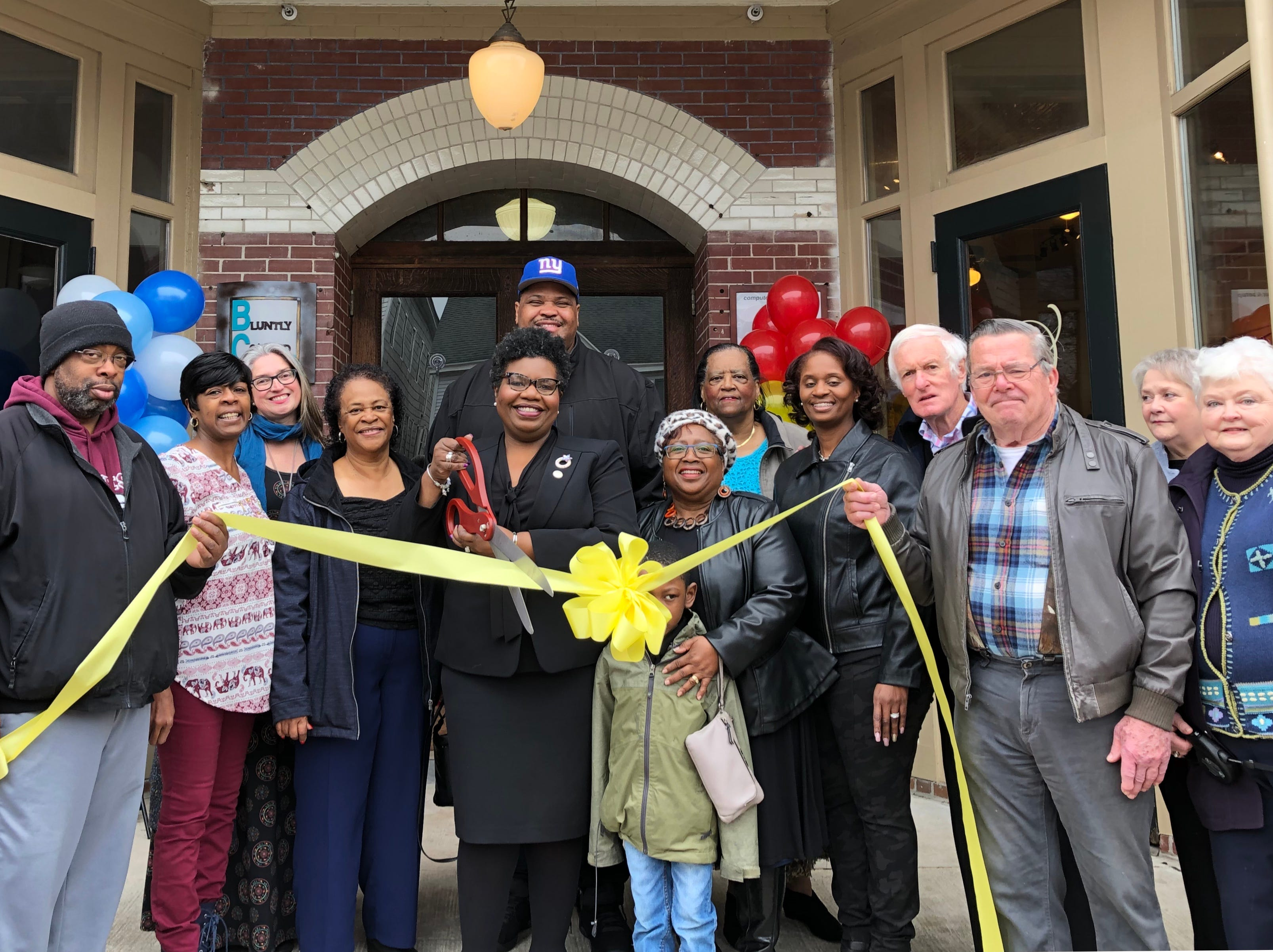 Orlena Williams cuts the ribbon in front of her new Princess Anne store, O Grace & Glory Boutique on Saturday, Feb. 23, 2019.