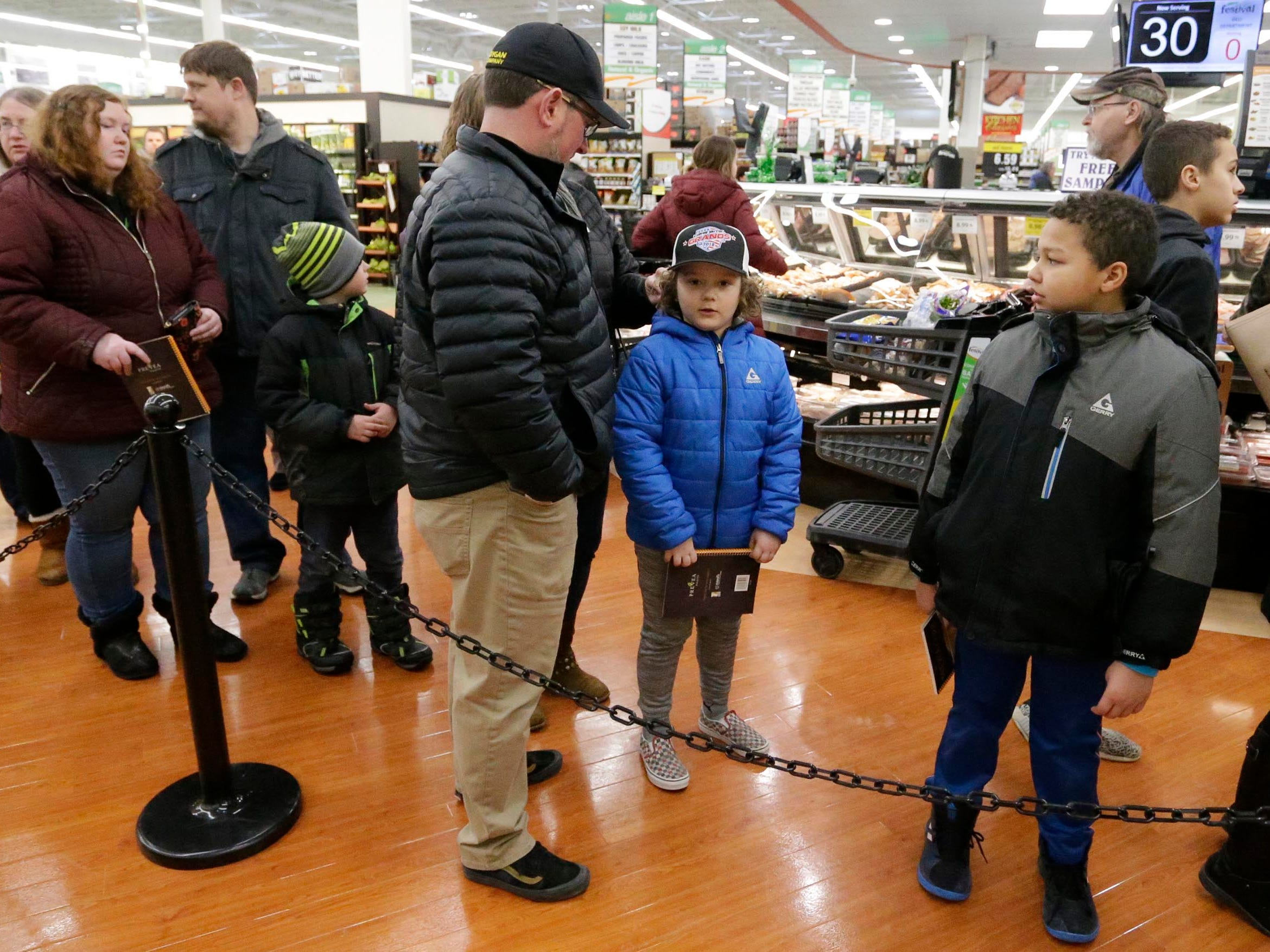 """People line up to have Green Bay Packer Randall Cobb sign his cookbook called, """"Prevea Gets Cooking with Cobb: Randall's Favorite Kid-Friendly Recipes"""", Thursday, February 28, 2019, in Sheboygan, Wis."""