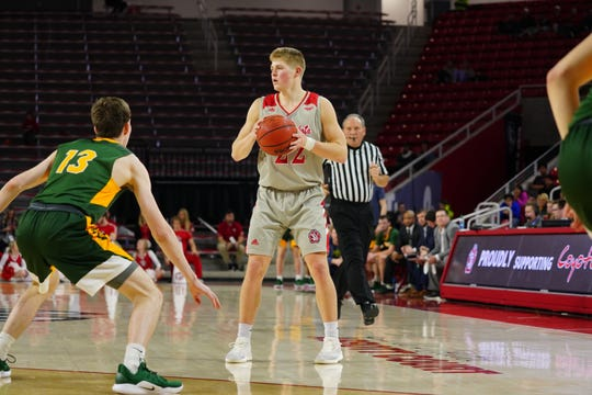 South Dakota guard Tyler Peterson looks to pass against North Dakota State on Thursday, Feb. 28 in Vermillion.