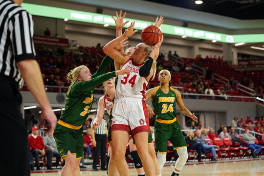 South Dakota center Hannah Sjerven goes in for a shot against the North Dakota State defense on Thursday, Feb. 28 in Vermillion.