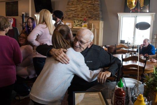 Emma Kuiper, 12 hugs George VanDenHul, Thursday, Feb. 28, 2019 in Harrisburg, S.D. Harrisburg is dedicating an entire day to George VanDenHul, a longtime bus driver of 50 years.