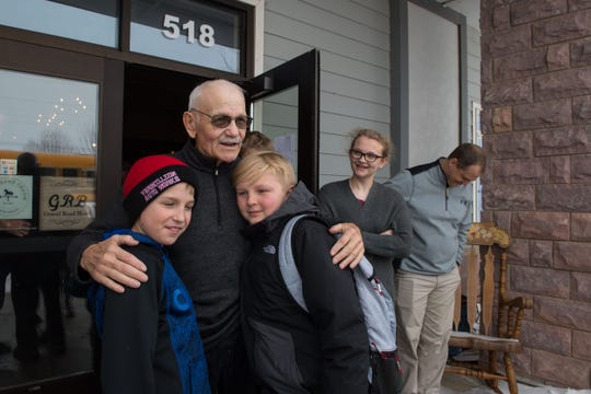 George VanDenHul hugs his former bus riders, Thursday, Feb. 28, 2019 in Harrisburg, S.D. Harrisburg is dedicating an entire day to George VanDenHul.