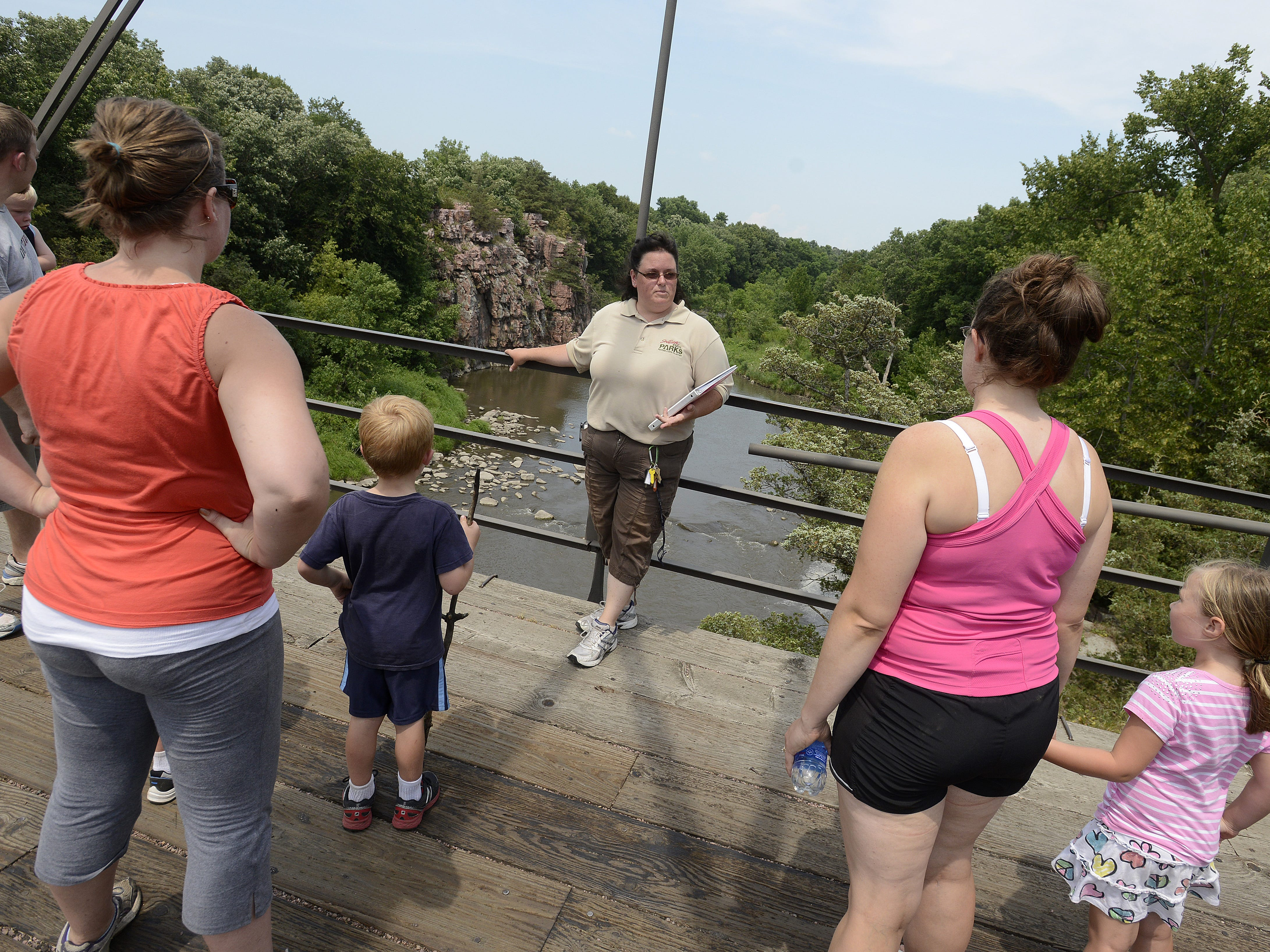 Jen Nuncio, a naturalist at Palisades State Park leads visitors on a tour of the park during a celebration for the park's 40th birthday Sunday, July 1, 2012.
