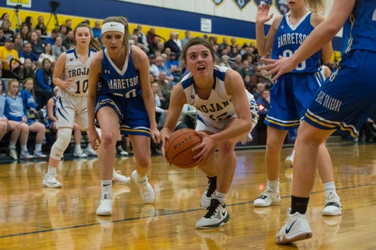 West Central's Kali Nelson (12) dribbles the ball past Garretson players during a game, Thursday, Feb. 28, 2019 in Tea, S.D.