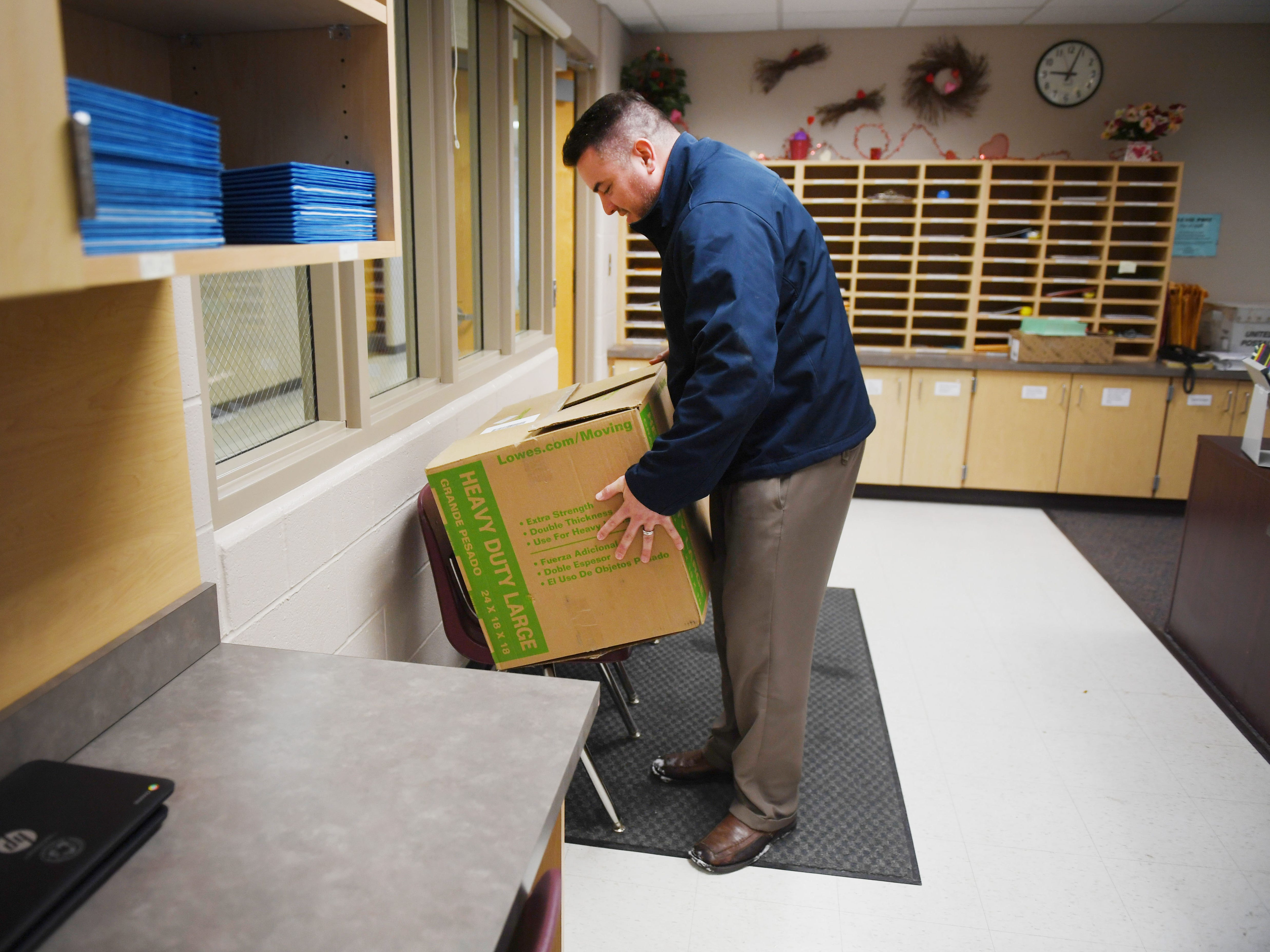Tony Martinet, Sioux Falls Education Association President, delivers a Little Free Library to Cleveland Elementary School Friday, March 1, in Sioux Falls. Martinet went to six elementary schools to drop of the Little Free Libraries. He said they have a total of 10 Little Free Libraries they want to give to schools. Four of the libraries are still available.