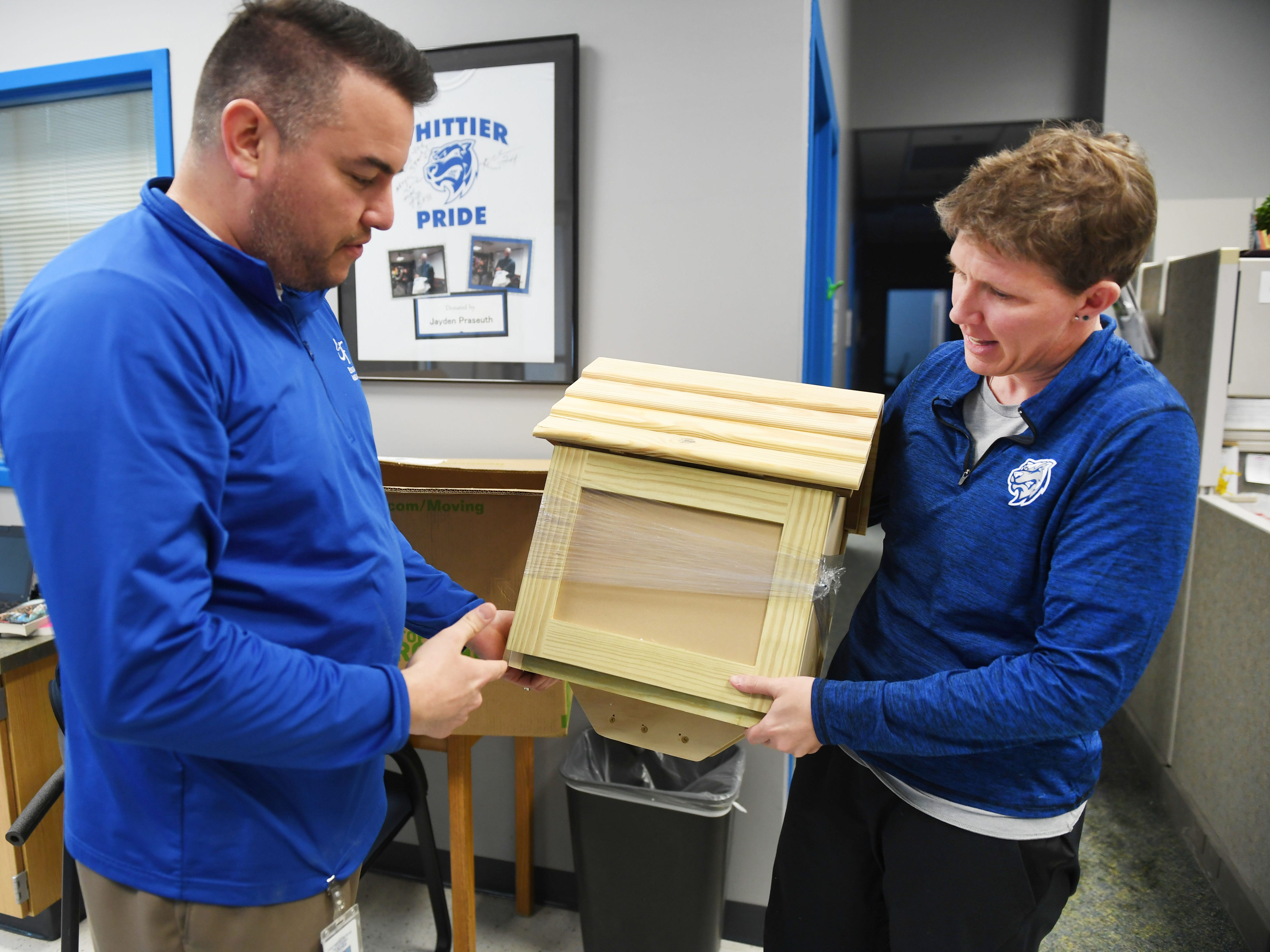 Tony Martinet, Sioux Falls Education Association President, delivers s Little Free Library to Whittier Middle School's principal Jayne Zielenski Friday, March 1, in Sioux Falls. Martinet went to six elementary schools to drop of the Little Free Libraries. He said they have a total of 10 Little Free Libraries they want to give to schools. Four of the libraries are still available.