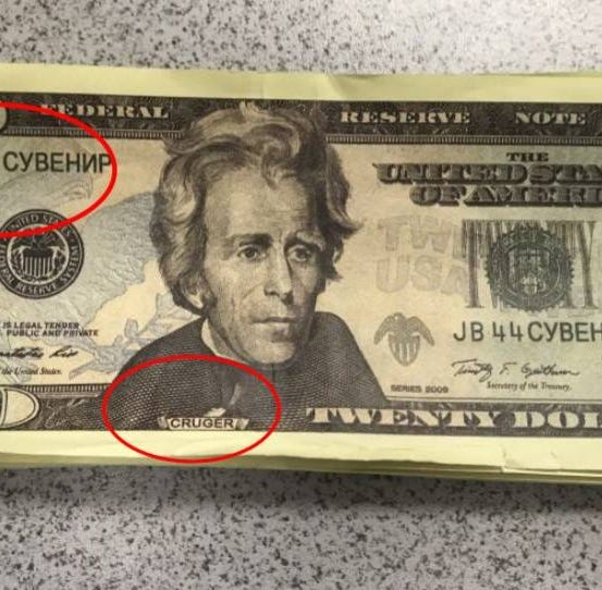 Why are businesses getting duped by fake cash with Chinese and Russian markings?