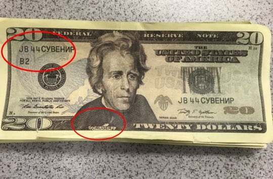 """An example of a fake $20 bill that includes the Russian characters indicating the bill is a souvenir, and renaming President Andrew Jackson as """"Cruger."""" The bill was obtained by the Le Mars, Iowa, Police Department."""