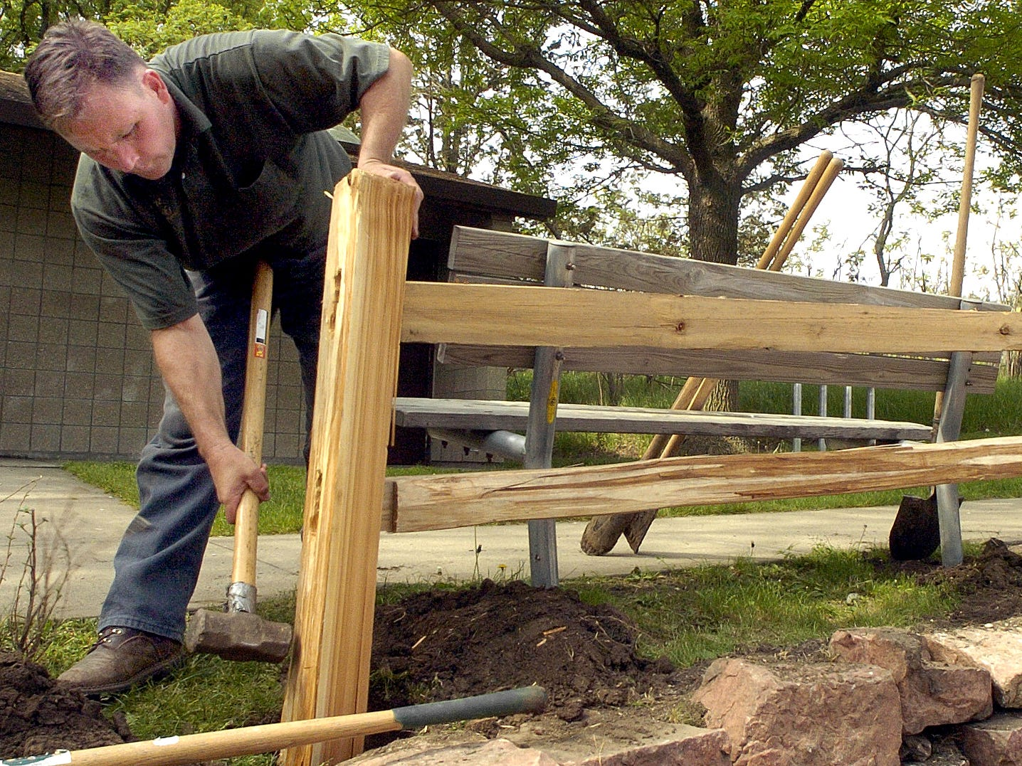 Mark Robinson, left, conservation technician and Eric Boyda, park maintenance, build a section of new fence near the bathrooms at Palisades State Park as the park prepares for Memorial Weekend visitors May 23, 2006.