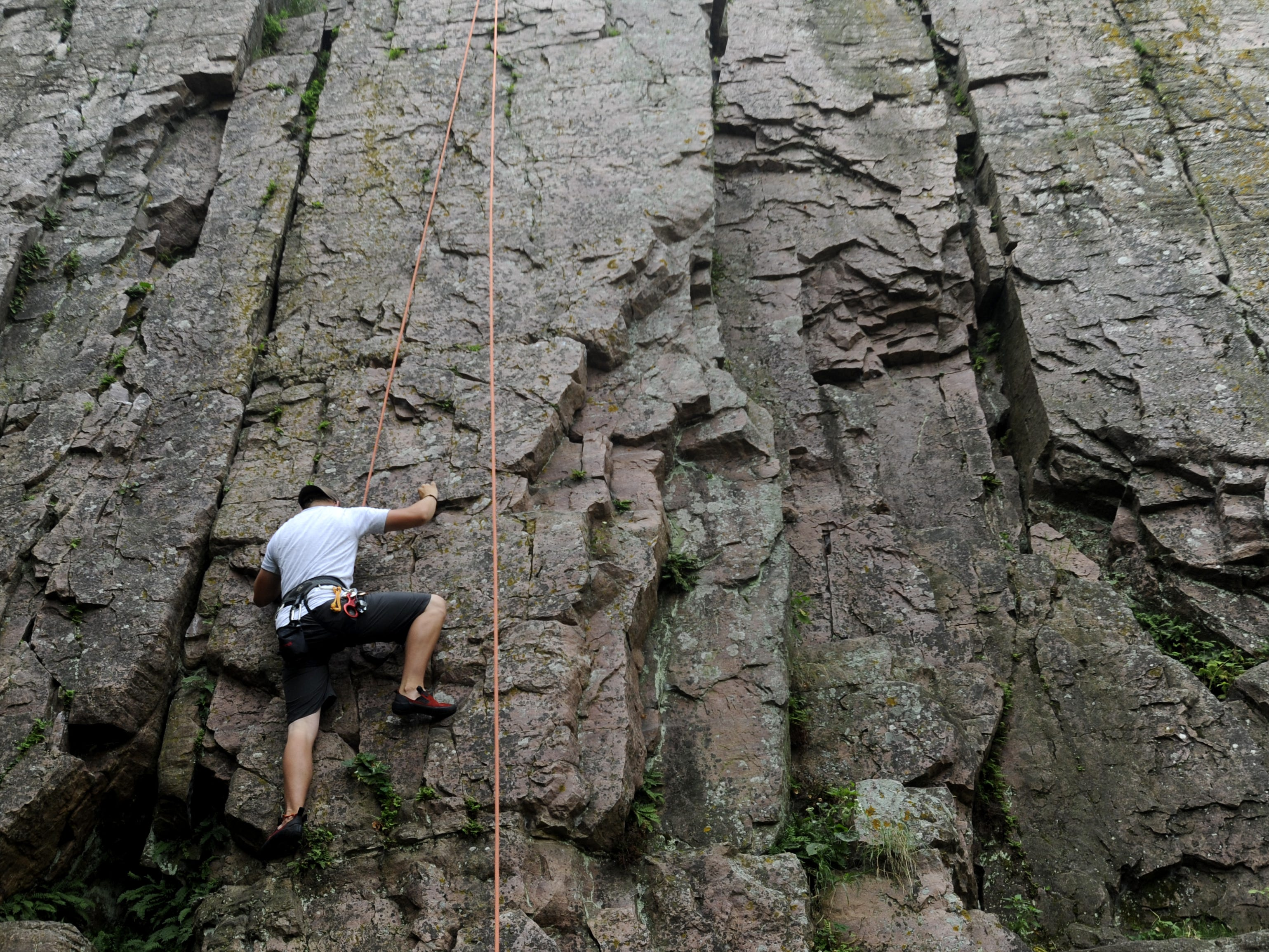 Andy Te Slaa scales the south wall at Palisades State Park while rock climbing with Clint Whitley, both of Sioux Falls, Monday. The two were scouting climbs for a class they are leading September 13th and 20th through the Outdoor Campus.