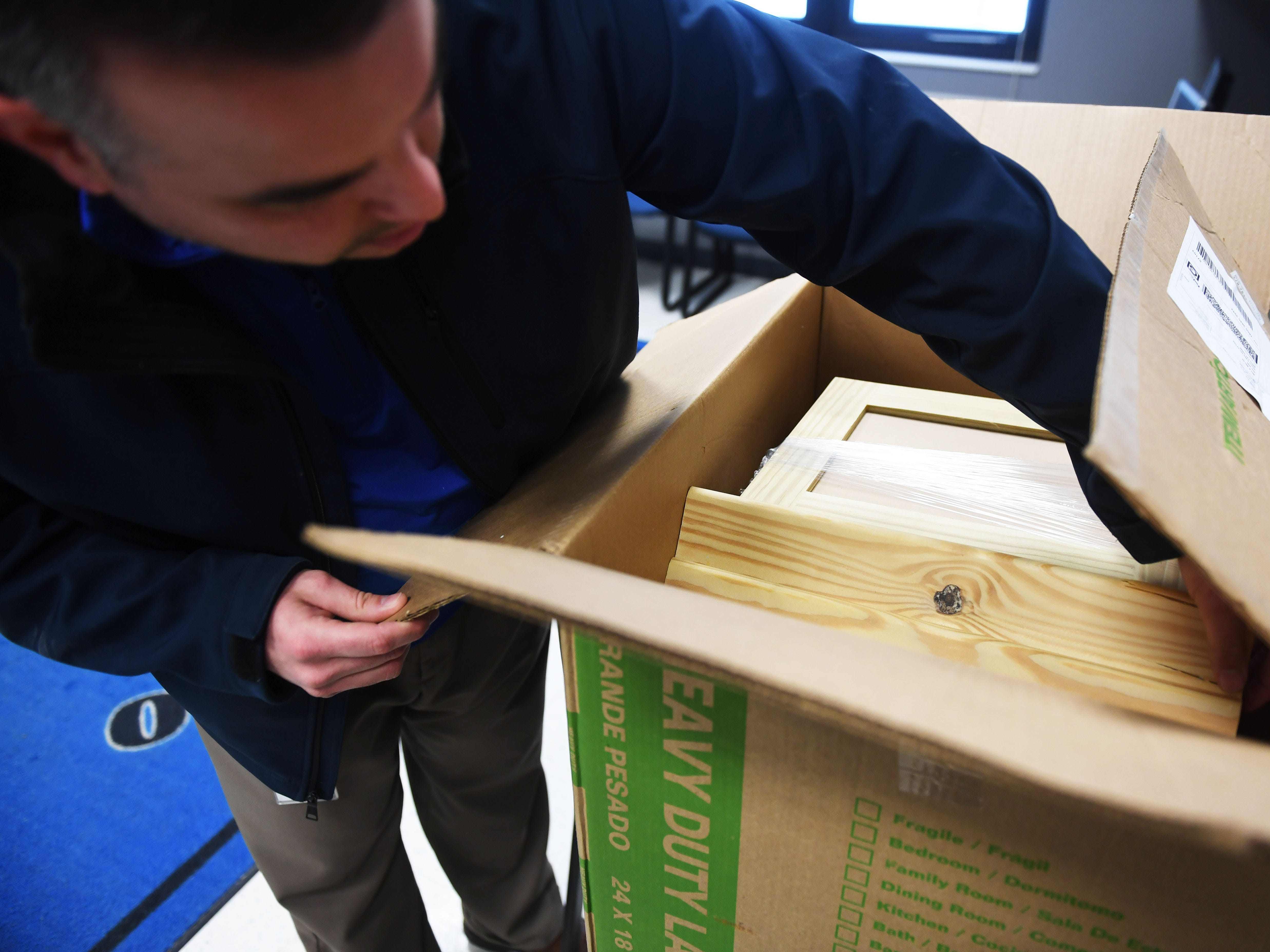 Tony Martinet, Sioux Falls Education Association President, carries a Little Free Library into Whittier Middle School Friday, March 1, in Sioux Falls. Martinet went to six elementary schools to drop of the Little Free Libraries. He said they have a total of 10 Little Free Libraries they want to give to schools. Four of the libraries are still available.